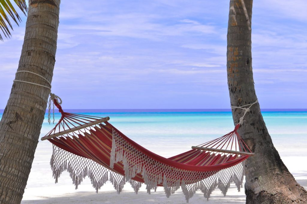 A beach hammock is one of things to bring to the beach