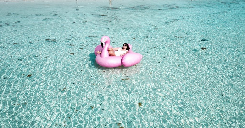 this flamingo float is one of the items that should be on your beach packing list